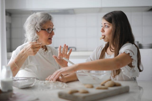 pensive-grandmother-with-granddaughter-having-interesting-3768146